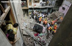 The debris of a collapsed building in New Delhi