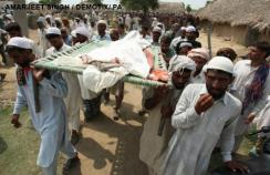 Indian villagers carry a dead body