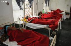 Indian women who underwent sterilization surgeries receive treatment at the District Hospital in Bilaspur