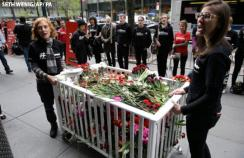 MSF deliver the petition in a crib filled with flowers to Pfizer world headquarters in New York