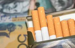 packet of cigarettes + Australian dollars