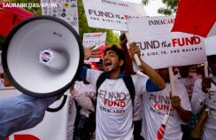 Activists and people affected with HIV hold a rally to urge China, Germany, and Japan to step up their contributions to the Global Fund to fight AIDS, tuberculosis, and malaria