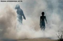 A worker fumigates with a pesticide to curb the breeding of mosquitoes in Colombo, Sri Lanka