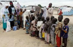 Health workers administer the polio vaccine in Nigeria