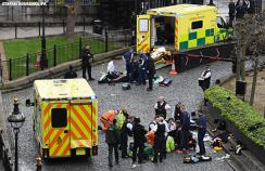 Emergency services attend a man (top) and a police officer (bottom) outside the Palace of Westminster