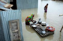 People move to other place after flooding in Bangladesh