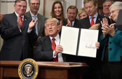 Trump signing the executive order