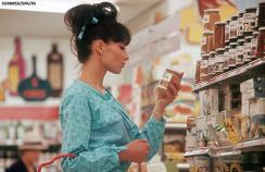A woman food shopping in the 1970s