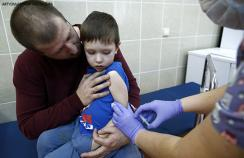 A child having the MMR vaccine