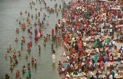 People wash in the Ganges, one of many rivers across the world contaminated with medicines