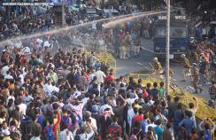Police use a water cannon in Guwahati, India to disperse demonstrators during a protest against the Citizenship Amendment Bill