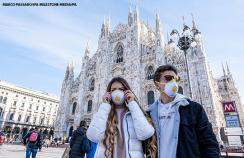 People wearing masks in Piazza Duomo, Milan, Italy