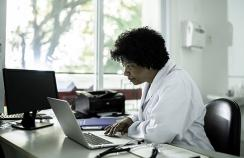 Doctor at her laptop