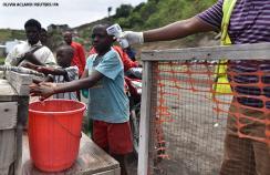 A health worker checks the temperature of a Congolese child amid the covid-19 outbreak in Goma, eastern Democratic Republic of Congo