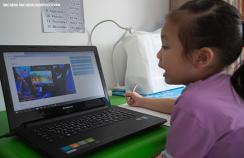 A child in Thailand learning at home during school closures