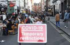 People socialising in Soho, central London