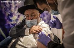 A man receives the vaccine in Israel