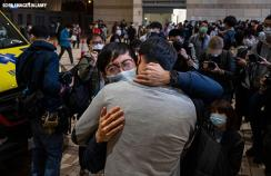 Supporters cry and comfort each other after hearing bail results at West Kowloon Court in Hong Kong
