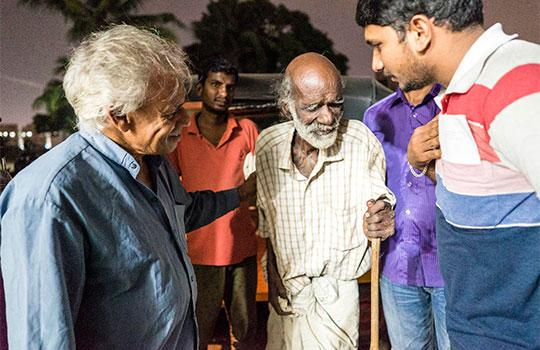 Father Thomas Rathappillil welcomes a man to one of his hospices in Tamil Nadu